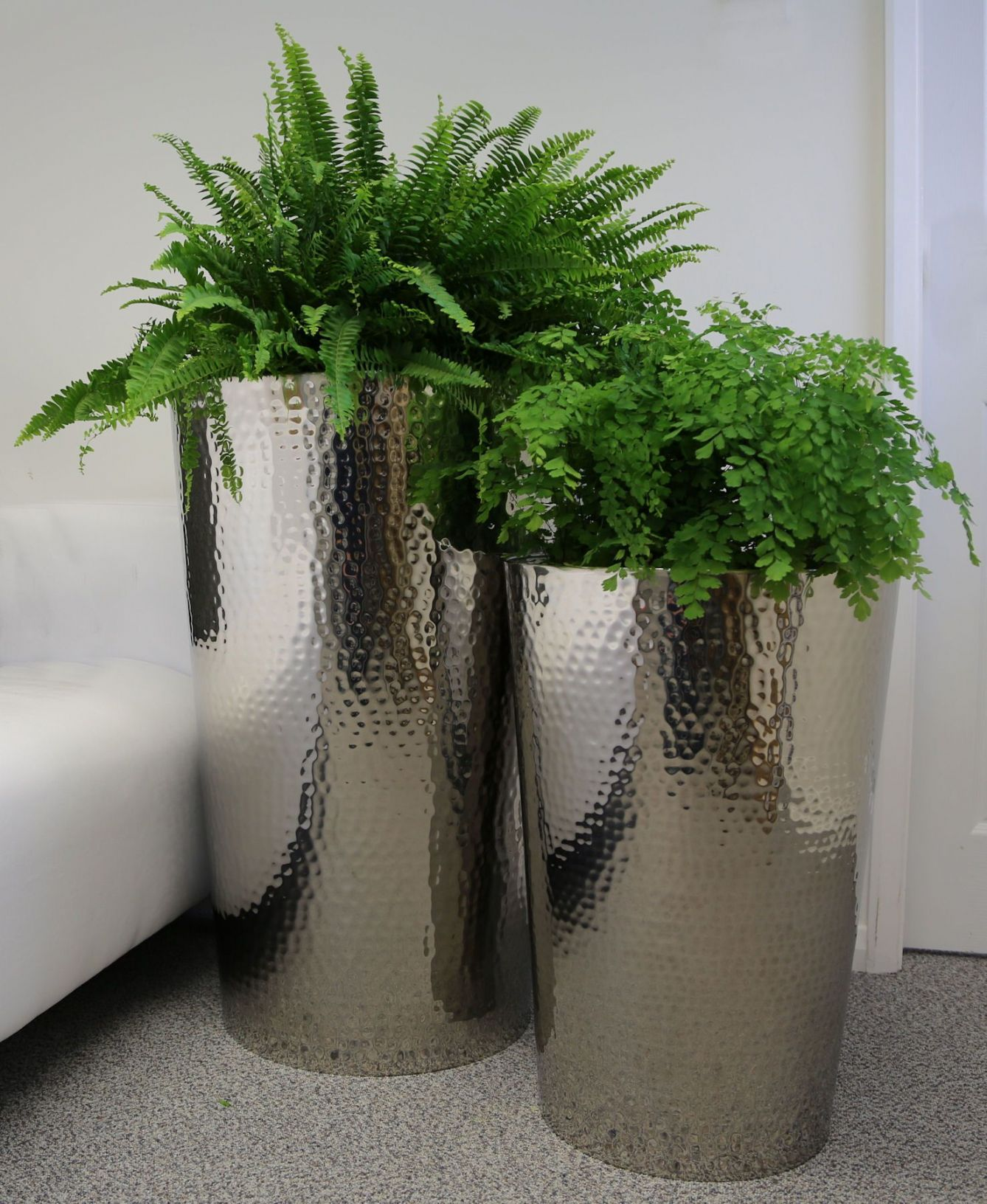 Hammered stainless steel tapered round planters from potstore workwithnaturefo